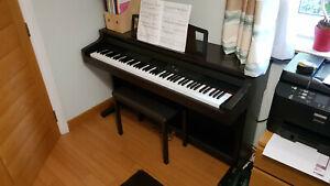 Yamaha Clavinova CLP 611 full size digital piano with 88 weighted keys and stool