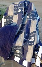 Dallas Cowboy Quilt measures 68 by 60 inches, official NFL Fabric. Stars quilted
