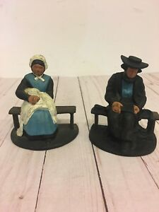 Vintage Cast Iron Amish Man And Woman Seated On Bench Figurine Book Ends.