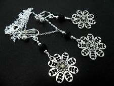 A PRETTY FLOWER  TIBETAN SILVER  NECKLACE AND CLIP ON EARRING SET. NEW.