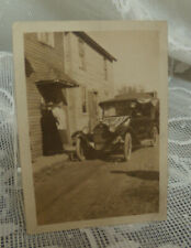 Vintage antique photo old car with a flag covering the hood -neat old photo