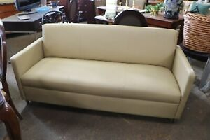 Neutral leather like vintage sofa from Gaylord Opryland hotel - Good