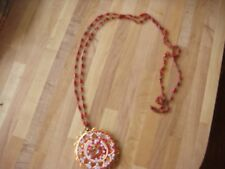 red enamel, beads and metal accents 2.25 in pendant on red bead & metal 21 chain