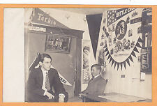 Real Photo Postcard Rppc - Two Men Interior with Tarkio & Battle Creek Pennants