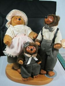 """ROBERT RAIKES FAMILY OF THREE BEARS. 2@12"""" - 1 @ 8"""" ON WOODEN STAND"""
