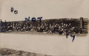 WW1 soldier group Kitchener's Army resting during route march in marching Order