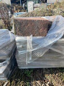 Reclaimed red sandstone blocks
