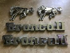 1984 - 1990 FORD BRONCO II FRONT FENDER HORSE AND NAMEPLATE EMBLEMS SET OF 4PCS
