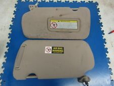2002-2003 Nissan Maxima OEM sun visors (both, brown and stained)
