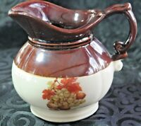 McCoy Pottery Pitcher, fall leaves and grapes on front brown glaze