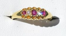 Antique 18ct yellow gold ruby and diamond trilogy ring