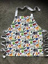 TODDLER'S CRAFT/COOKERY APRON MACHINE WASHABLE LINED. WILD ANIMALS DESIGN