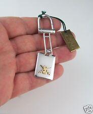 Portachiavi in argento 800 con parti in oro giallo