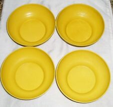 set of 4 vintage Tupperware bowls , yellow colour