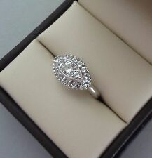 STRIKING POLISHED 10K WHITE GOLD WHITE ZIRCON EAST WEST HALO RING - 2.7 GRAMS