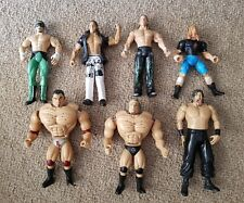 BULK LOT OF WWE AND WRESTLING ACTION FIGURES X 7. BATISTA, SHAWN MICHAELS & MORE