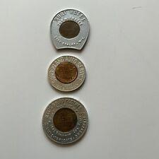 3 Encased Coins, Merchant 1935 Mel's Clothes, 1954 Sunderland Auto, 1945 Geneva