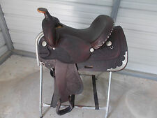 """15"""" Circle Y trail saddle with leather seat and tooled leather with some silver"""