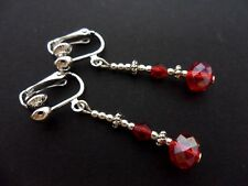 A PAIR OF SILVER PLATED RED CRYSTAL  BEAD DANGLY  CLIP ON EARRINGS. NEW