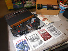 Vintage Atari 2600 game lot 4 controllers 21 games with booklets WOODY E.T.