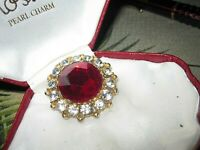 Beautiful vintage  goldtone  clear rhinestone & red fraceted glass  brooch