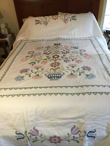 White hand embroidered and hand quilted queen size quilt