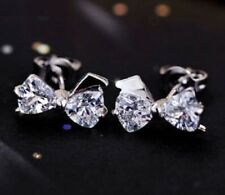 Silver tone sparkly crystal bow stud earrings