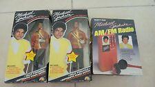 Two NRFB Michael Jackson collectible dolls and a rare NIB MJ AM /FM radio