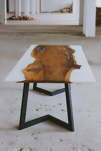 Handmade dining table made of the oak slab and white resin