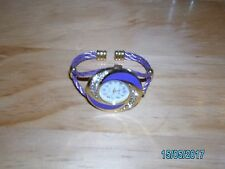 LADIES PURPLE AND DIAMANTE CUFF STYLE WATCH