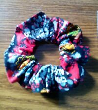 Chicago Blackhawks scrunchie, badge reel, & pink Weed whacker trimmer gas string