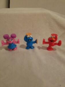 sesame street figurines cookie monster, elmo,