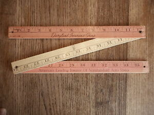 Vintage Wood Folding Ruler Measure Tool Pink Dairy land Insurance Auto