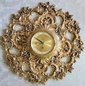 MID CENTURY SYROCO WOOD 8 DAY JEWELLED WALL CLOCK w/ORGINAL KEY & BAG. WORKING!