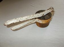 Vintage steel kitchen primitive hand operated juice squeezer strainer tool used