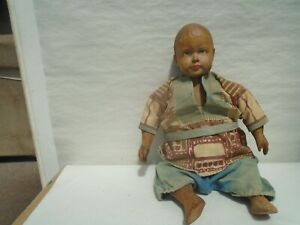 Charming vintage wooden doll with lovely hand painted face and ethnic costume