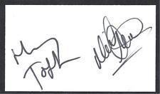 A 13cm x 7.5cm Plain White Card Signed by Harry Toffolo & Neil Adams of Norwich