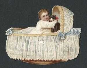 Y28 - BABY AND KITTEN IN ROCKING CRIB - STANDING DIECUT VICTORIAN XMAS CARD