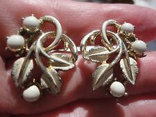 Vintage signed JEWELCRAFT white enamel bouquet 15 gram leverback clip earrings.