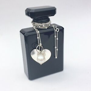 Long sterling silver necklace with large freshwater pearl and silver heart