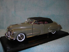 1/18 DIECAST 1947 CADILLAC SERIES 62 CABRIOLET TOP UP IN OLIVE GREEN BY ANSON.