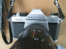 Pentax K1000 SE, with Pentax-A zoom 28-80mm & small flash.