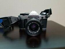 Canon Ae-1 Program 35mm Film Camera, Manual, and Accessories