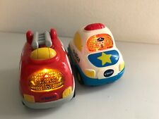Lot of 2 Vtech Go Go Smart Wheels, White Police Car & Red Fire Truck with Sounds