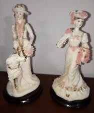 2 élégantes statuettes en résine style art déco