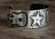 sterling silver cuff bracelet with guitars and stars