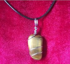 Handmade wire wrapped crystal pendant. Tigers Eye on black cord necklace