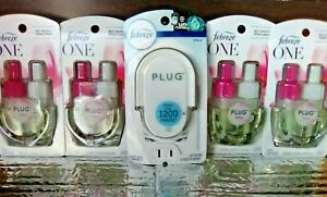 4 Febreze ONE LOTUS SCENT Plug Scented Oil refills and 1 Warmer