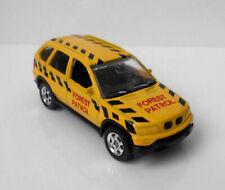 """°° Welly - BMW X5 - No 2057 - gelb - """"Forest Patrol"""" °°"""