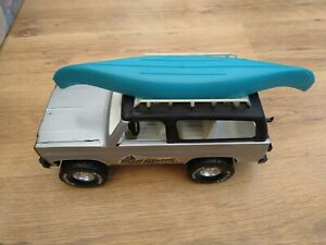 Vintage Nylint pressed steel and plastic Chevrolet Trailblazer With Canoe